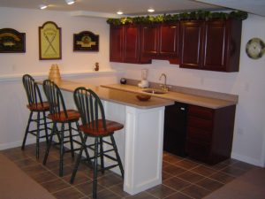 Basement remodeling often includes installing a wet bar