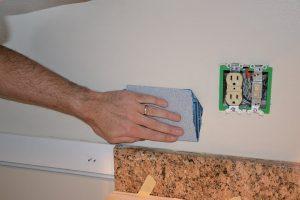 Sand tile area before tiling backsplash