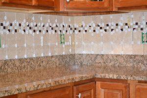 Tiled kitchen backsplash ready for grouting.