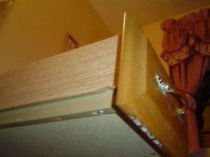 Fixing a bathroom cabinet drawer slide.