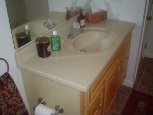 Installing a bathroom vanity on an uneven concrete floor.