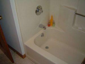 Installing a bathtub shower unit.