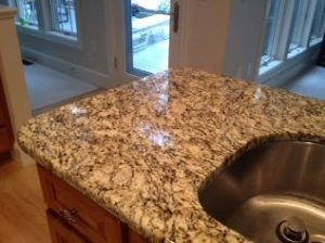 Installing granite countertops as part of a kitchen remodel.