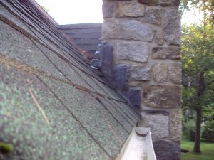 A chimney cricket directs shedding water from the roof around the chimney.