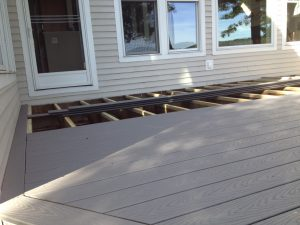 Composite decking boards being installed on this deck.