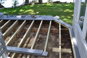 Deck floor joists exposed after removing old pressure treated deck boards