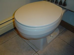 Replacing a cracked toilet.